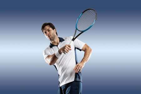 individual sport: Tennis player playing on blue background. Stock Photo