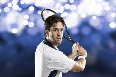 individual sport: Tennis player playing on blue lights background.