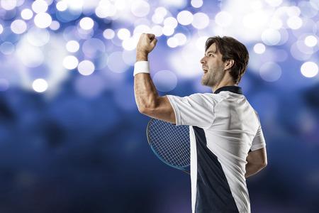 Tennis player celebrating, on a blue lights background.