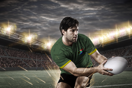 South African rugby player, wearing a green and gold uniform in a stadium. Standard-Bild