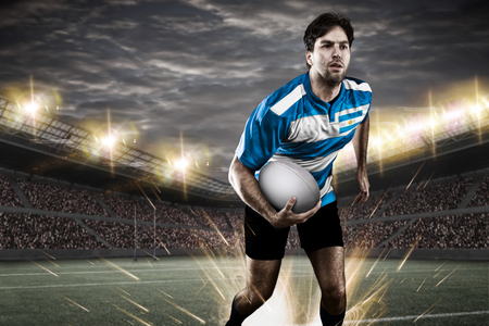 argentinean: Argentinean rugby player, wearing a blue and white uniform in a stadium.