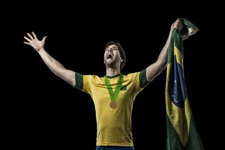 Brazilian Athlete Winning a golden medal on a black Background.