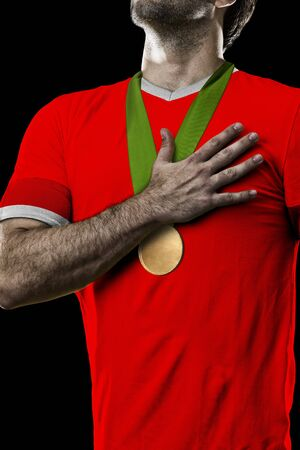 canadian football: Canadian Athlete Winning a golden medal on a black Background.