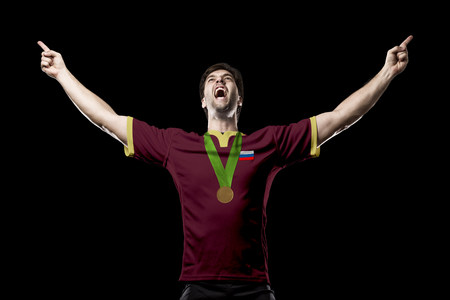nationalistic: Russian Athlete Winning a golden medal on a black Background.