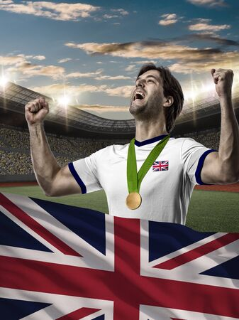British Athlete Winning a golden medal with a British flag in front. Stock Photo