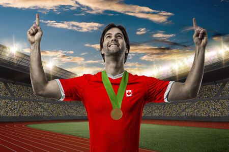 canadian football: Canadian Athlete Winning a golden medal on a Track and field stadium.