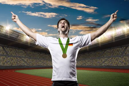 German Athlete Winning a golden medal on a Track and field stadium.