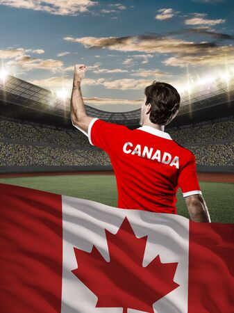 canadian football: Canadian Athlete with a Canadian flag in front.