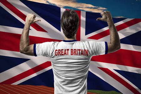 nationalistic: British Athlete in front of a British flag. Stock Photo