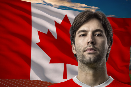 canadian football: Canadian Athlete Winning a golden medal in front of a Canadian flag.