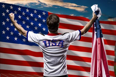 nationalistic: American Athlete in front of a american flag.