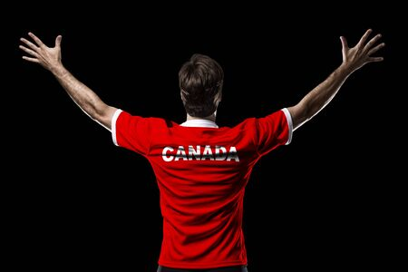 canadian football: Canadian Athlete on a black Background. Stock Photo