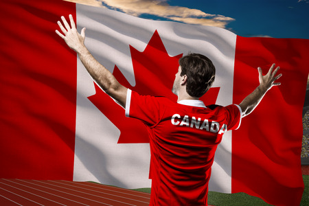 Canadian Athlete in front of a Canadian flag.