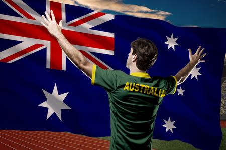 Australian Athlete Winning a golden medal in front of a Australian flag.