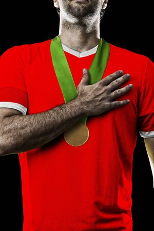 Canadian Athlete Winning a golden medal on a black Background.