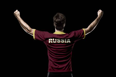 Russian Athlete on a black Background. Stock Photo