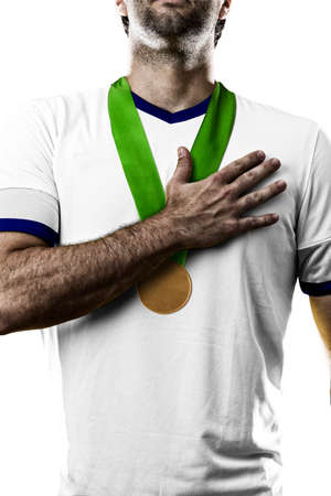 British Athlete Winning a golden medal on a white Background. Stock Photo