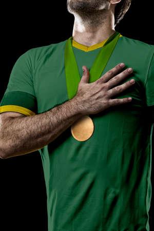magazine stack: Australian Athlete Winning a golden medal on a black Background.