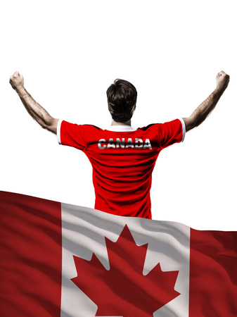 Canadian Athlete with a Canadian flag in front.