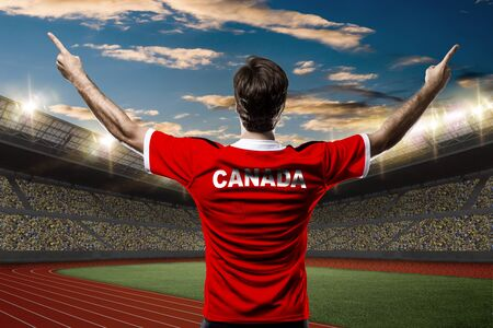 canadian football: Canadian Athlete on a Track and field stadium.