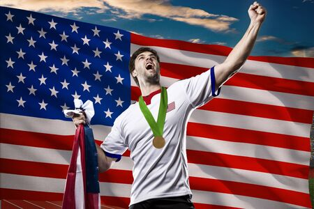 nationalistic: American Athlete Winning a golden medal in front of a american flag.