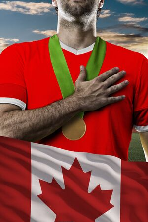 nationalistic: Canadian Athlete Winning a golden medal with a Canadian flag in front.