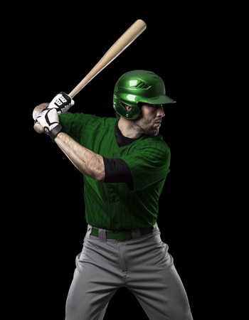 tough man: Baseball Player with a green uniform on a black background.
