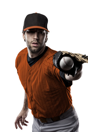 tough man: Baseball Player with a orange uniform on a white background. Stock Photo