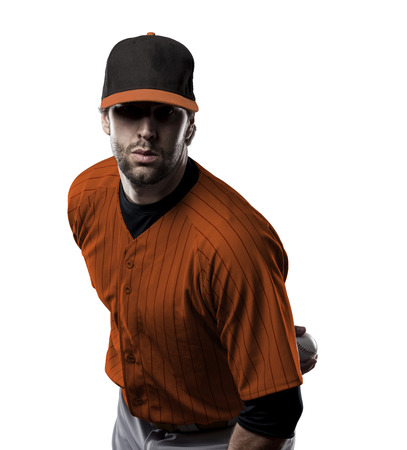 Pitcher Baseball Player with a orange uniform on a white background. Stock Photo