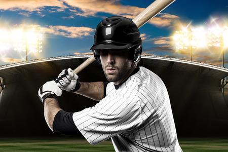toughness: Baseball Player with a white uniform on baseball Stadium.