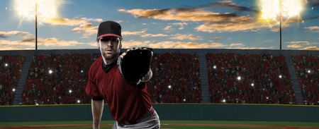 Baseball Player with a red uniform on baseball Stadium. Stock Photo