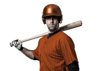 Baseball Player with a orange uniform on a white background. Stock Photo