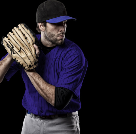 toughness: Pitcher Baseball Player with a blue uniform on a black background.