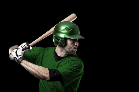 toughness: Baseball Player with a green uniform on a black background.