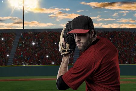 Pitcher Baseball Player with a red uniform on baseball Stadium.