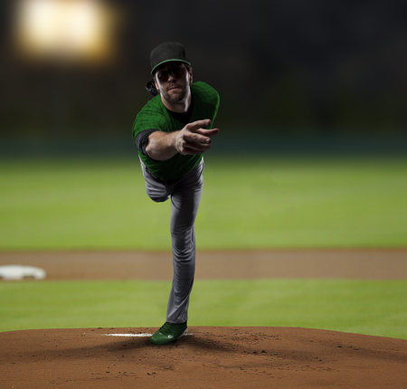 toughness: Pitcher Baseball Player with a green uniform on baseball Stadium.
