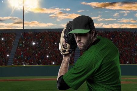 Pitcher Baseball Player with a green uniform on baseball Stadium.