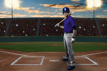toughness: Baseball Player with a blue uniform on baseball Stadium. Stock Photo