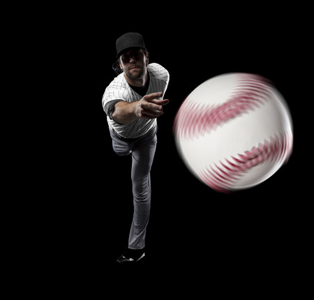 Pitcher Baseball Player with a white uniform on a black background.