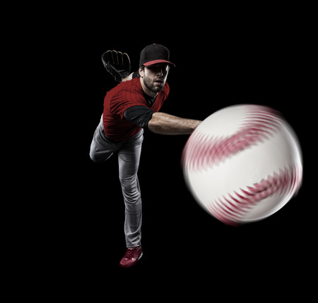 Pitcher Baseball Player with a red uniform on a black background. 版權商用圖片