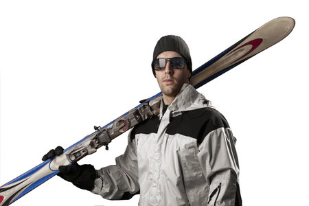 Skier with a white jacket, holding a pair of skis on a white background.
