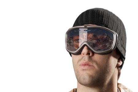 skier looking for a snowy mountain on a white background. Stock Photo