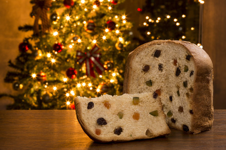 Brazilian panettone, a traditional pastry in Brazilian Christmas with a Christmas lights in the background. Stock Photo