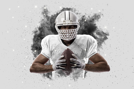 Football Player with a White uniform coming out of a blast of smoke . Stock Photo