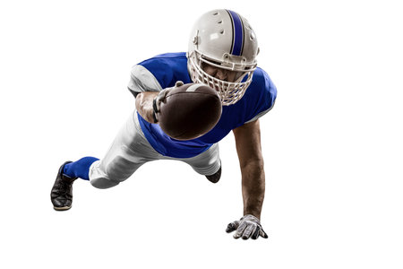 Football Player with a blue uniform scoring on a white background. Stock Photo