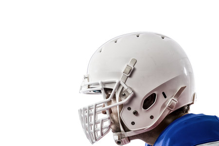 Close up of a Football Player with a blue uniform on a White background.