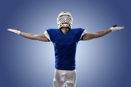 Football Player with a blue uniform celebrating, on a blue background.