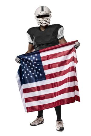 Football Player with a black uniform and a american flag, on a white background.