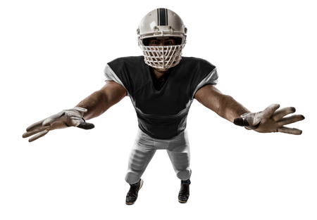 Football Player with a black uniform making a tackle on a white background.