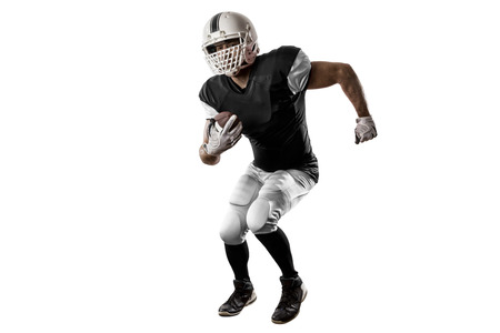 Football Player with a black uniform Running on a white background. Stock Photo